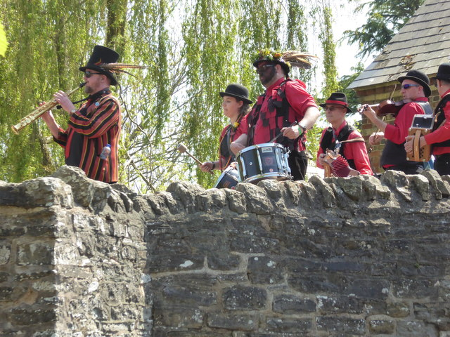 Part of the Clun Green Man procession on the bridge in 2018