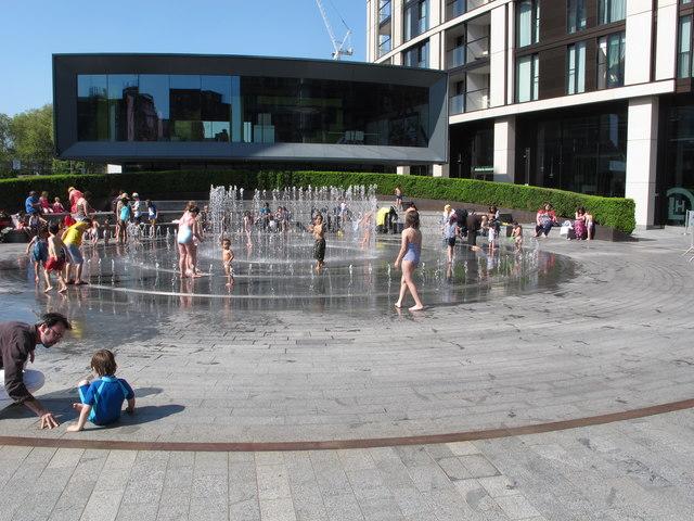 Fountain by Paddington Basin on a hot bank holiday