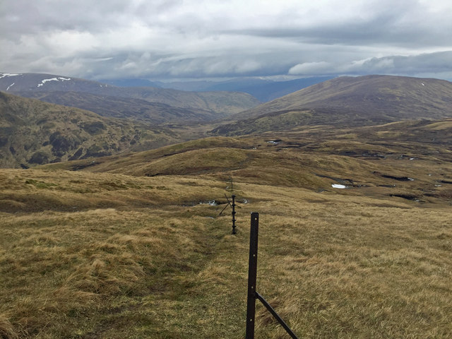 Looking down the fenceline on Meall Corranaich