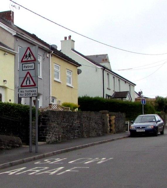 Warning signs alongside Gellihaf Road, Fleur-de-lis