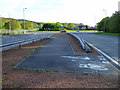NS2173 : Cycle lane at Bankfoot roundabout by Thomas Nugent