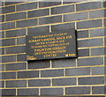 SX8860 : March 2010 plaque on a Paignton Library and Information Centre wall by Jaggery