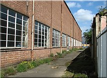 TG2407 : Alley between two industrial buildings by Evelyn Simak