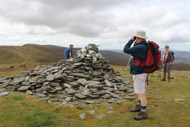 Walkers by cairn on summit of Cadair Bronwen