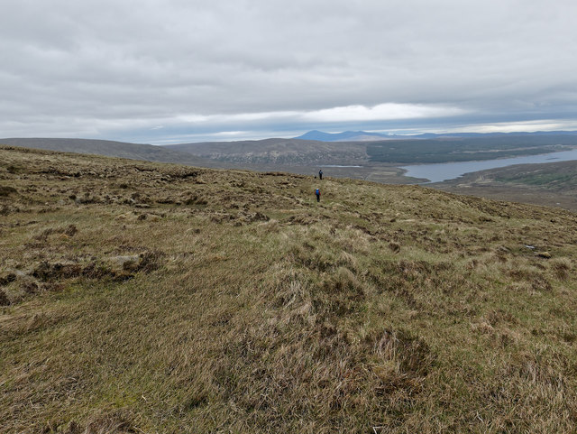 Walking out to Loch Shin after five hours in the hills