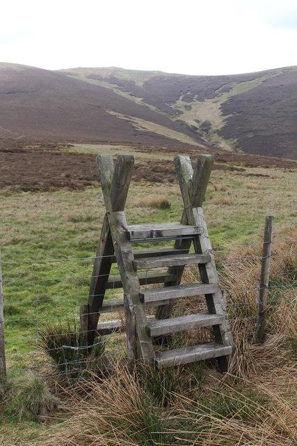 Stile on pathway below Cadair Berwyn