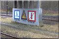 NZ2558 : Warning signs at Tyne Yard by Robert Eva
