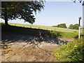 SE2944 : Cyclist on Eccup Lane by Stephen Craven