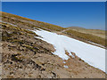 NH9802 : Snow patch on the slope of Cairn Lochan by John Allan