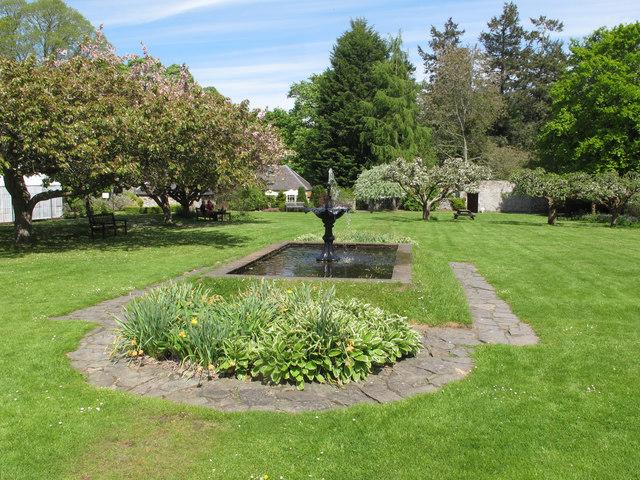 Traquair garden, fountain, apple trees