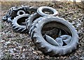 TQ7820 : Discarded tyres in Brede High Wood woodyard by Patrick Roper