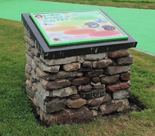 A cairn and information board at the Rowan Boland Play Park at Galashiels