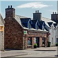 NH8399 : Pharmacy and Post Office Golspie by valenta