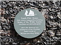 TM5593 : Plaque on South Flint House by Adrian S Pye