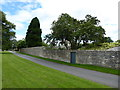 SO8703 : Garden wall, Nether Lypiatt Manor by Vieve Forward