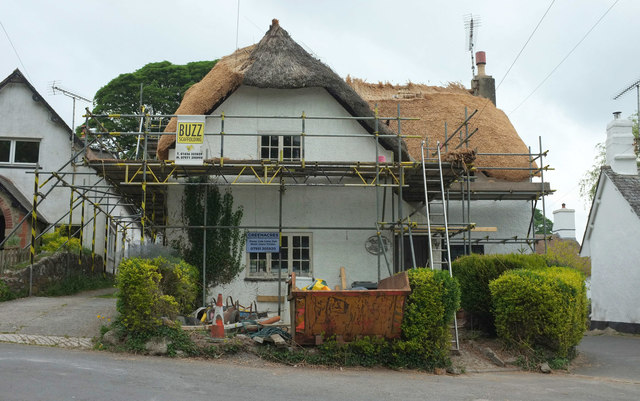 Cottage being rethatched straw, North Bovey