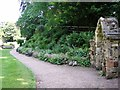 TG2208 : The Plantation Garden - path past Gothic alcove by Evelyn Simak