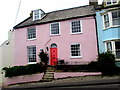 SY3391 : Pink house with a red door and a blue plaque, Cobb Road, Lyme Regis by Jaggery