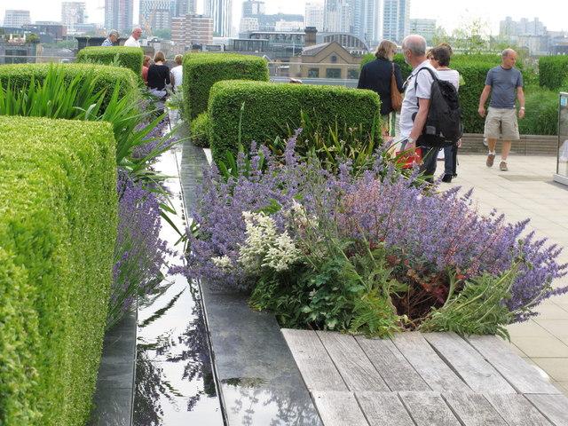 Water feature, flower beds, topiary, Nomura roof garden
