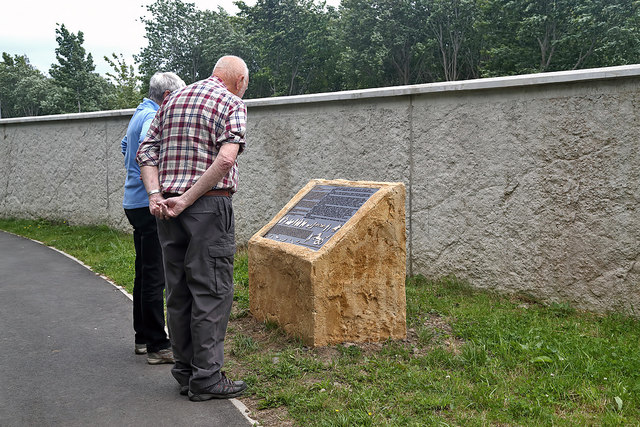 A plinth and information board on a riverside walk in Selkirk
