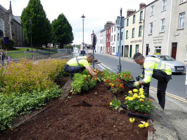 Planting flowers, Omagh by Kenneth  Allen