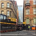 SJ8497 : Low loader squeezing into the north end of Back George Street, Manchester by Robin Stott