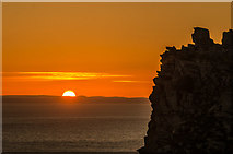 SS7049 : Sunrise behind Castle Rock by Ian Capper