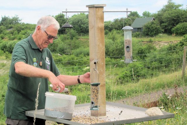 Filling the Bird Feeders by the Visitor Centre at College Lake