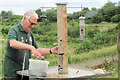 SP9313 : Filling the Bird Feeders by the Visitor Centre at College Lake by Chris Reynolds