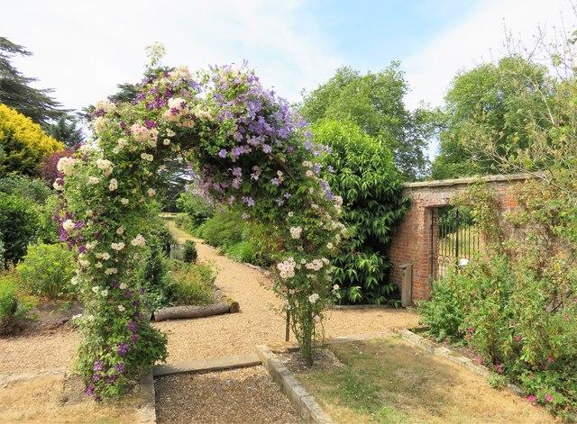Flowering shrub arch in Stow Hall Gardens, Norfolk