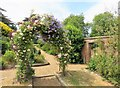TF6305 : Flowering shrub arch in Stow Hall Gardens, Norfolk by Richard Humphrey