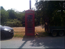 TM3569 : Telephone Box on the A1120 The Street by Adrian Cable