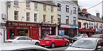 J0407 : Shops in Church Street, Dundalk by Eric Jones