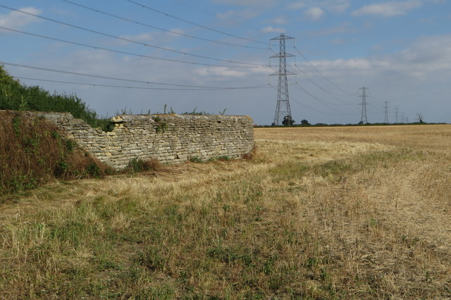 Pylons striding across the wheat