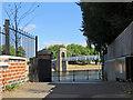 SK5737 : Floodgate and Suspension Bridge by John Sutton
