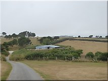 SX6644 : Road across Bigbury Golf Club by David Smith