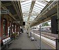 SU4766 : Temporary fencing on Newbury railway station by Jaggery