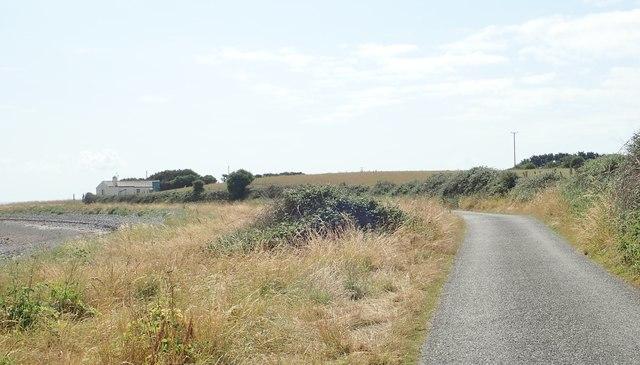 Bungalow at a bend in the coastal road at Ballagan