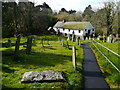 SX2099 : Poundstock churchyard and Gildhouse by Chris Gunns