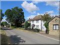 TL4349 : Newton: a summer morning in Town Street by John Sutton