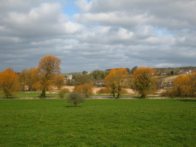 Colourful spring trees with Frampton Church in the distance