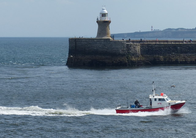Fishing boat passing the South Pier lighthouse