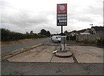 SO7403 : Abandoned petrol pumps in Slimbridge by David Howard