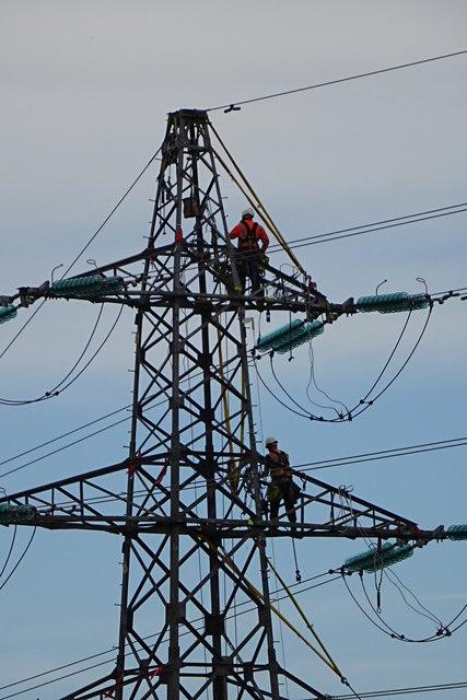 Workmen on a pylon