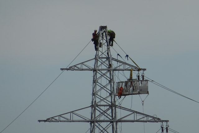 Workmen on a pylon