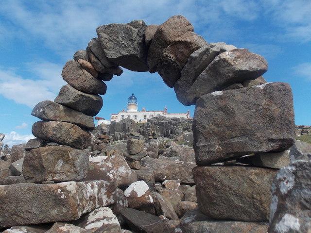 Neist Point: a rock arch frames the lighthouse