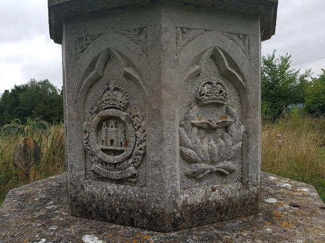 Regimental emblems on the Geldeston war memorial