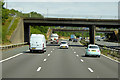SP0373 : M42, Bridges at Junction 2 by David Dixon