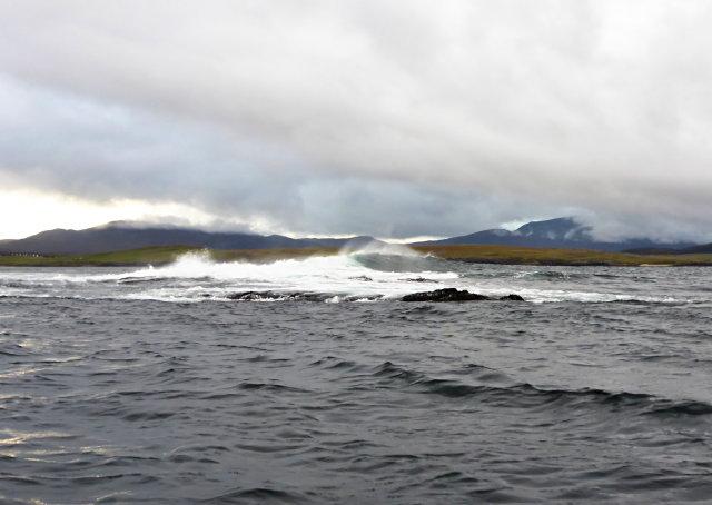 Wave breaking on a tidal rock