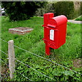 SY6097 : King George V postbox on a Maiden Newton corner by Jaggery